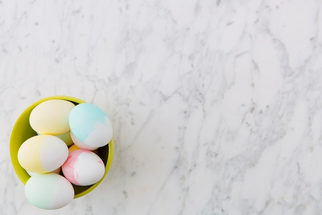 Colourful easter eggs in bowl