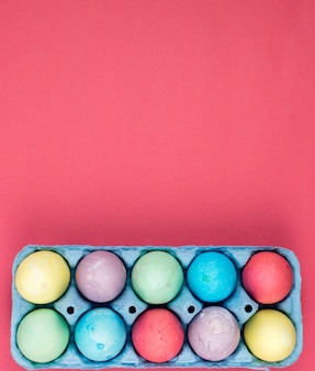 Colourful easter eggs in box on table