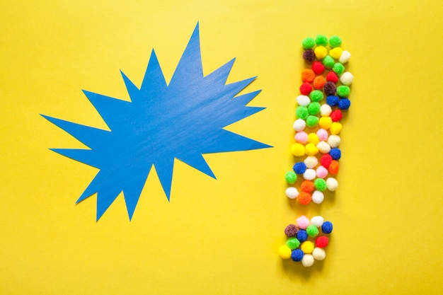 Colourful exclamation point from cotton balls
