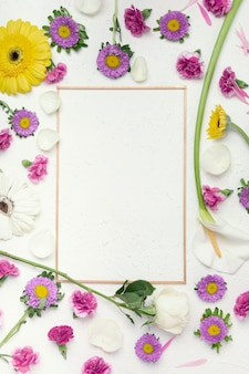 Colourful festive flowers background with vertical frame copy space