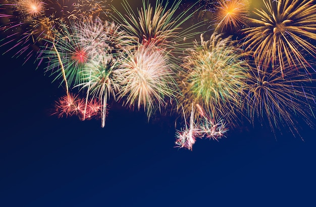 Colourful fireworks on blue twilight background to celebrate special occasion
