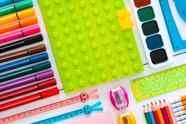 Colourful flat-lay stationery chalk board on white of the table