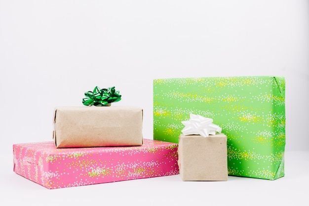Colourful gift boxes with bows on table