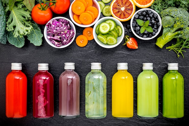 Colourful healthy smoothies and juices in bottles