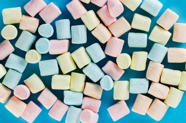 Colourful marshmallow background top view