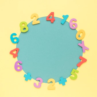 Colourful math numbers frame surrounding blue circular shape