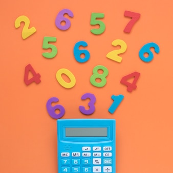 Colourful math numbers with calculator close-up