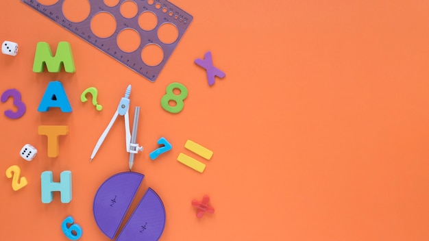 Colourful math numbers with compass and ruler top view