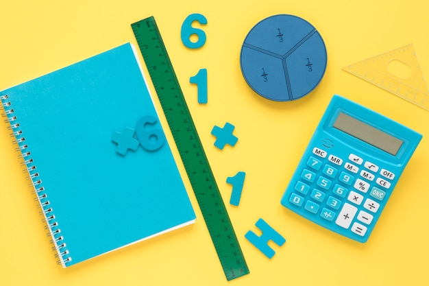 Colourful math numbers with notebook and calculator