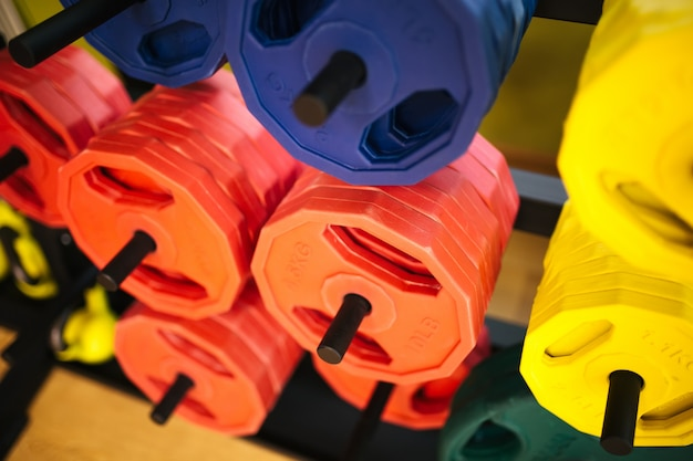 Colourful metal dumbbells from the bar. gym. equipment for a sports hall.