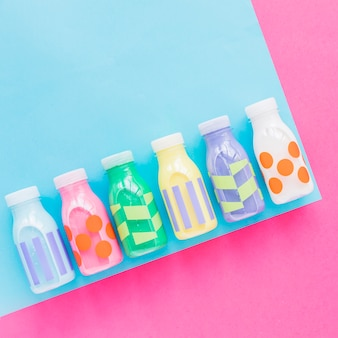Colourful milk bottles on bright table