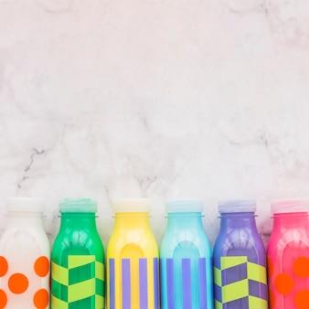 Colourful milk bottles on table