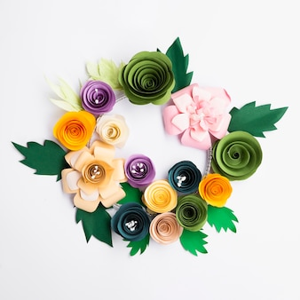 Colourful paper flowers frame on white background