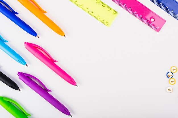 Colourful pens and rulers lie diagonally
