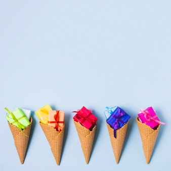 Colourful present in ice cream cones with copy space