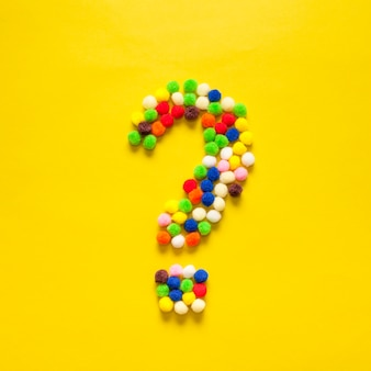 Colourful question mark from cotton balls
