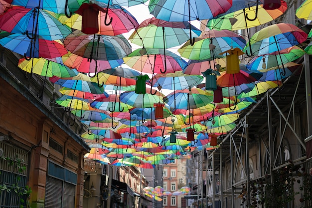 Colourful rainbow different color umbrellas. unban tourist street decoration. istanbul, karakoy