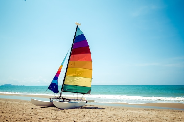 Colourful sailboat on tropical beach in summer