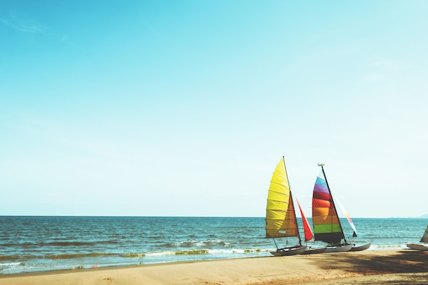 Colourful sailboat on tropical beach in summer.