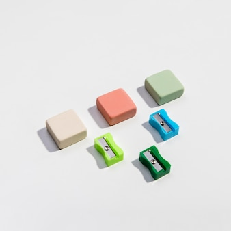 Colourful sharpeners and erasers high view