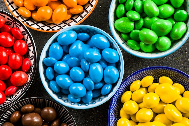 Colourfull candies in bowls