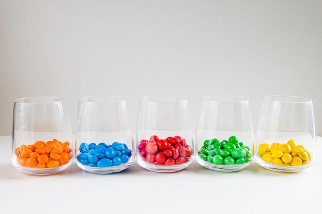 Colourfull candies in glasses Premium Photo
