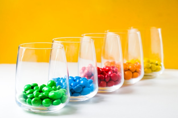 Colourfull candies in glasses