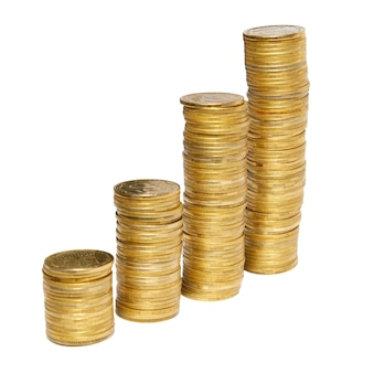 Columns of golden coins isolated on white.