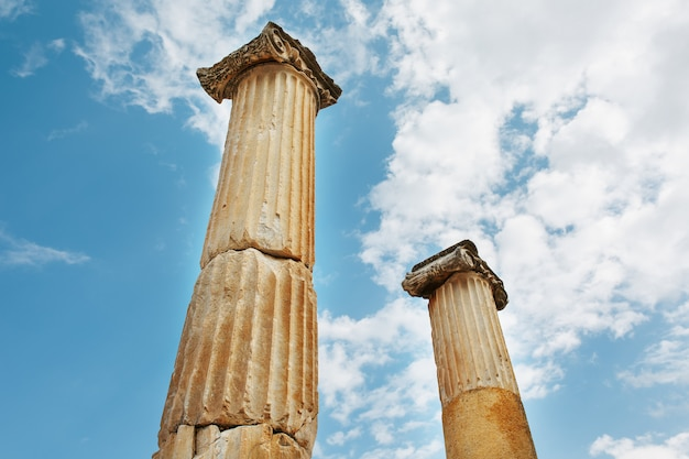 Columns the ruins of the ancient city of ephesus against the blue sky on a sunny day.