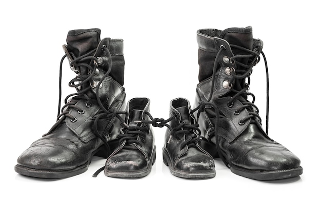 Combat boots for adult and kid in family concept isolated on white
