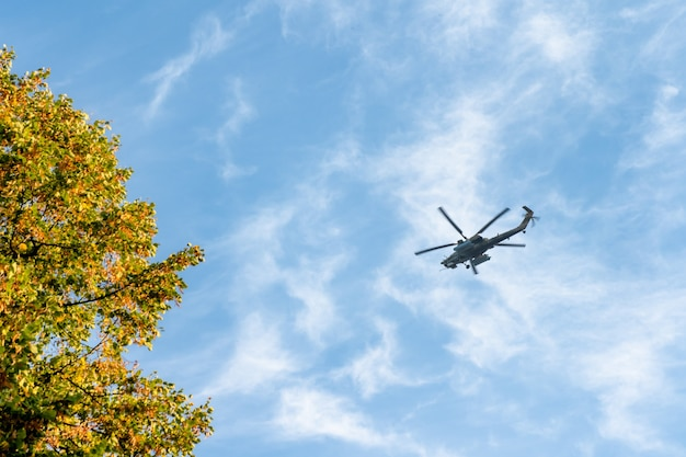 Combat helicopter flying across the sky