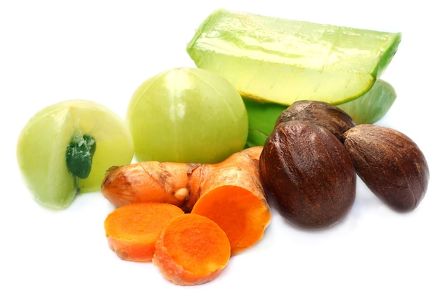A combination of ayurvedic fruits on white background