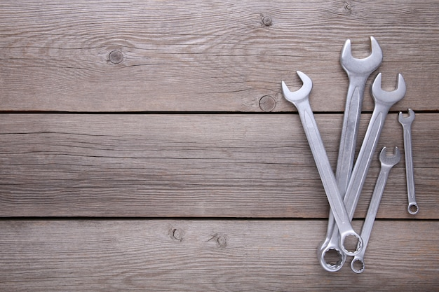 Combination wrenches for repair on grey background wooden