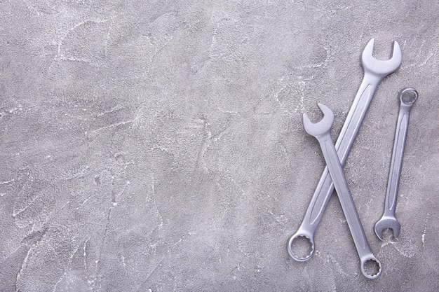 Combination wrenches for repair on grey background