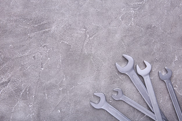 Combination wrenches for repair on grey concrete