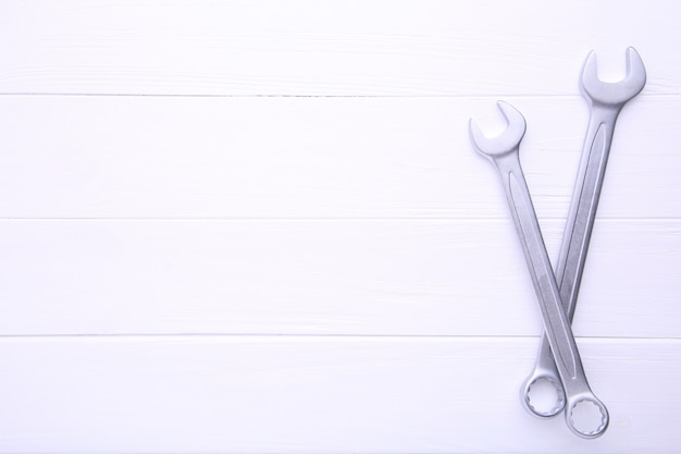 Combination wrenches for repair on white wooden table