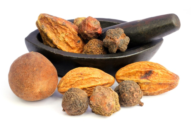 Combinations of herbal medicinal fruits with vintage mortar have property medicine.