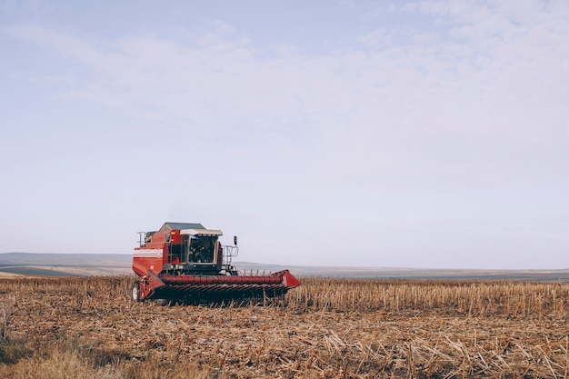 A combine harvester is standing in a field close-up.