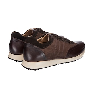 Combined leather shoes, brown leather and suede sneakers isolated on white surface