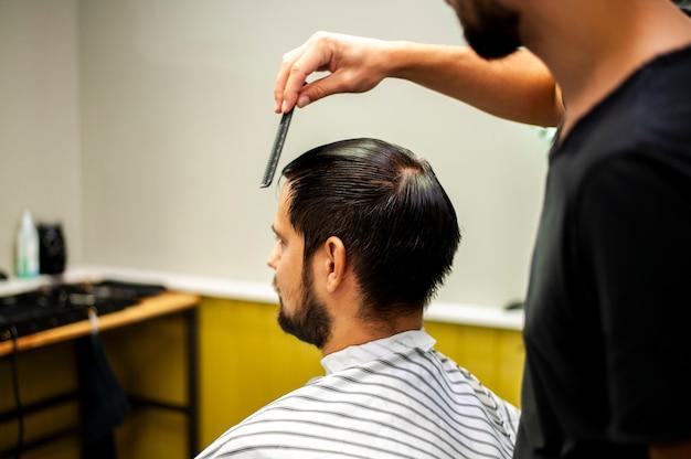 Combing hair over the shoulder shot