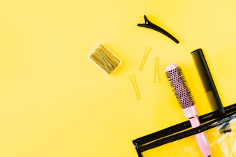 Combs and hairpins near cosmetics bag