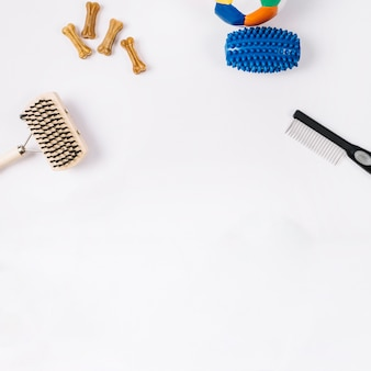 Combs near dog toys and dainties