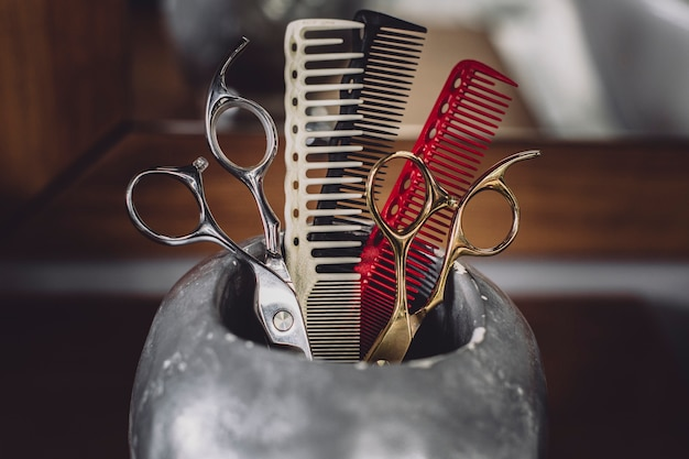 Combs and scissors in shop