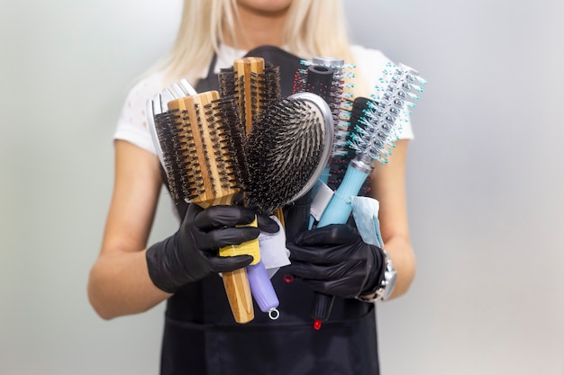 Combs for styling in female hands. professional hairdressing tools, equipment.