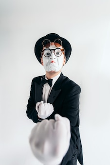 Comedy mime artist in glasses and makeup mask