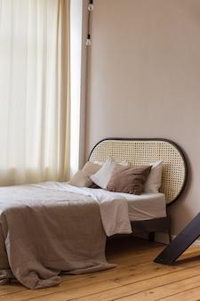 Comfortable bed in light bedroom