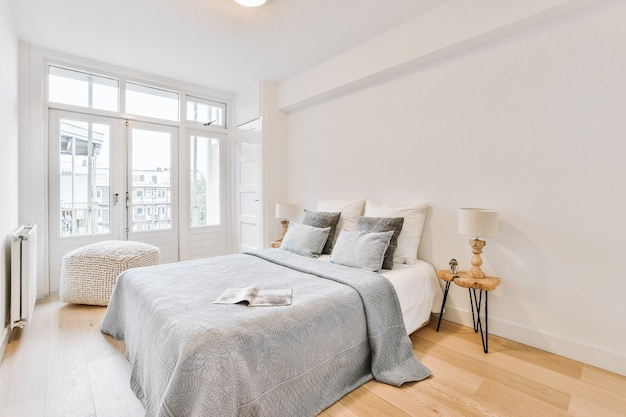 Comfortable beds located in bright bedroom in light apartment
