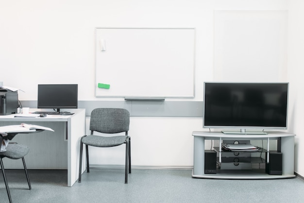 Comfortable business office in white tones with modern equipment