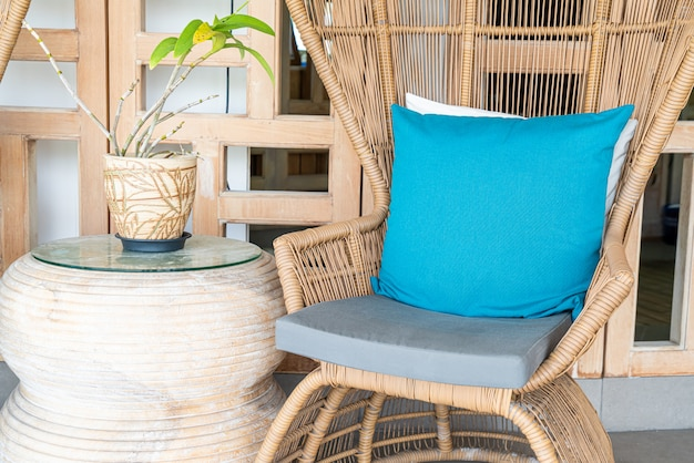 Comfortable chair with pillow on patio