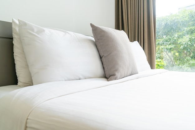Comfortable pillow decoration on bed in bedroom